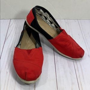 Toms red and black fabric slip on shoes